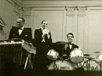 The event—one of the first public concerts to feature a racially integrated group—helped elevate the status of swing music, and included some of the brightest jazz luminaries of the day. Count Basie, making his Carnegie Hall debut, appeared as a guest, and members of Duke Ellington's orchestra also participated. Lionel Hampton and Gene Krupa, shown in this photo, were there, as were Buck Clayton, Johnny Hodges, Walter Page, Lester Young, Harry Carney, and Freddie Green.